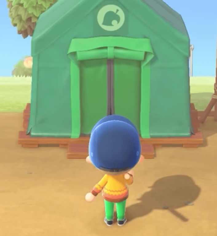 standing in front of timmy's green tent